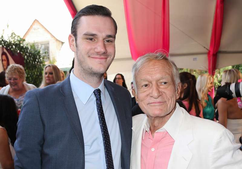 Playboy Founder Hugh Hefner and and his son Cooper Hefner attend the 2013 Playmate Of The Year announcement at The Playboy Mansion on May 9, 2013 in Beverly Hills, Calif.