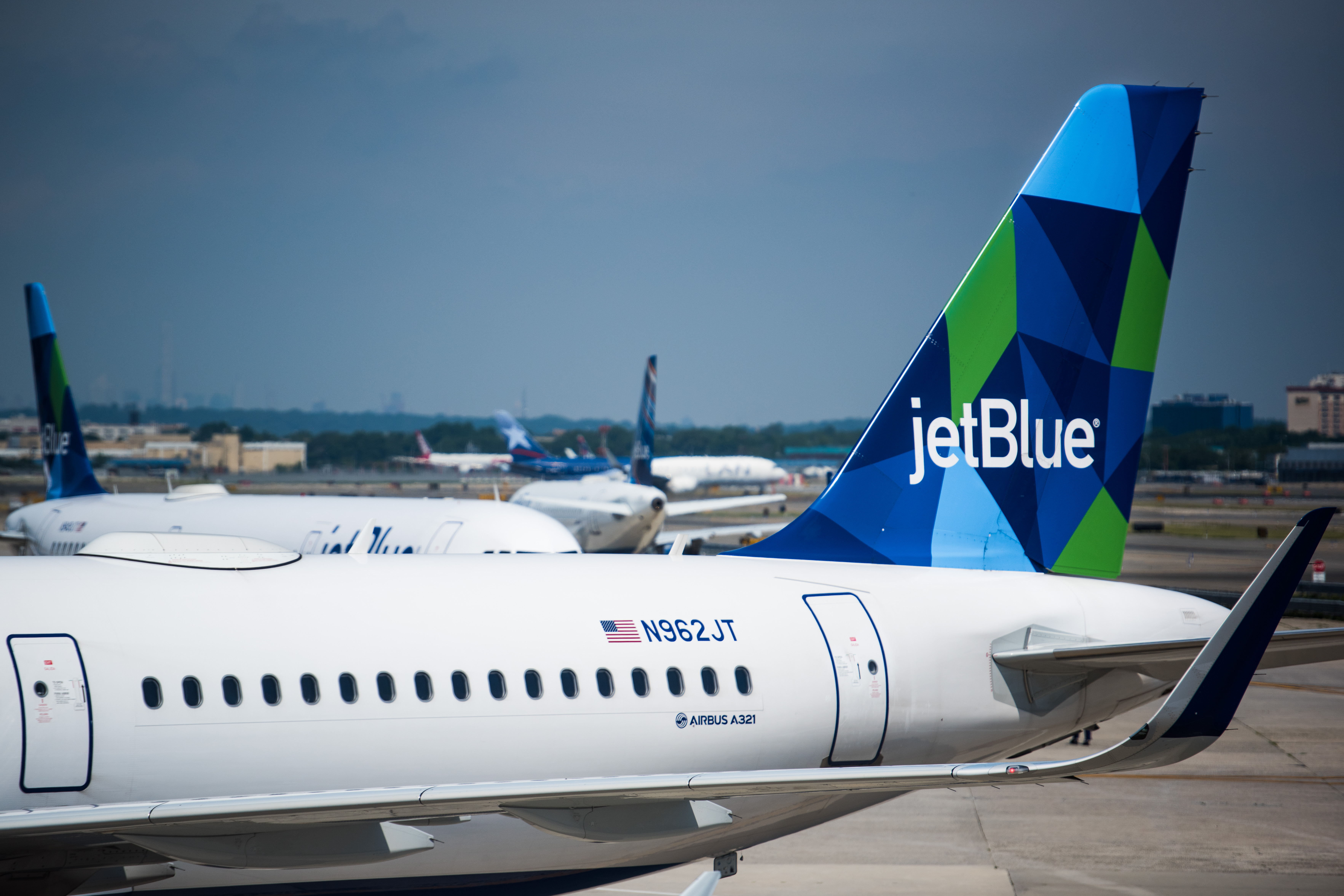 A JetBlue Airways Corp. Airbus A321 plane sits at a gate outside of Terminal 5 at John F. Kennedy International Airport (JFK) in New York on July 12, 2017.