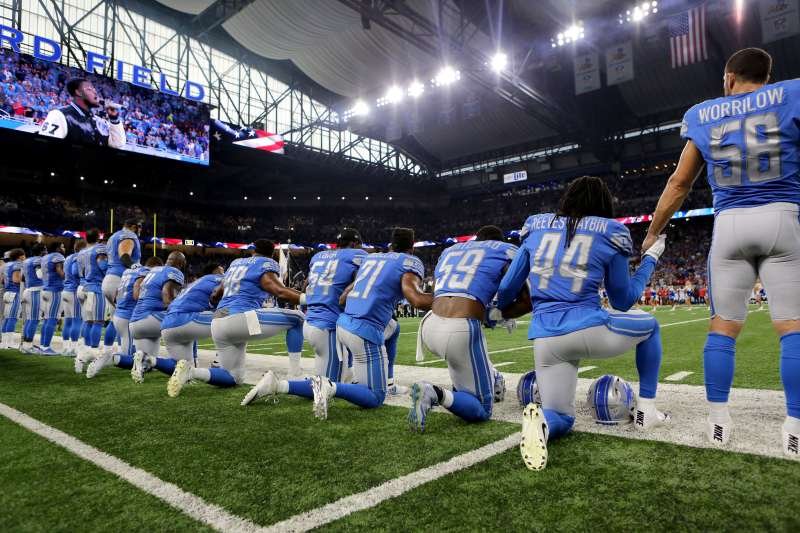 Members of the Detroit Lions take a knee during the national anthem before playing the Atlanta Falcons at Detroit's Ford Field on September 24, 2017.
