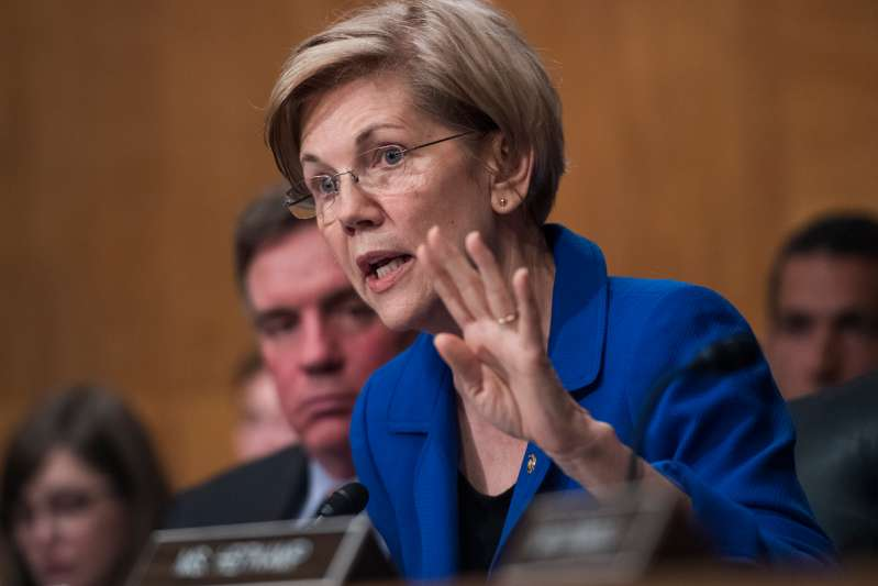 Sen. Elizabeth Warren, D-Mass., questions Richard Smith, CEO of Equifax, during a Senate Banking, Housing and Urban Affairs Committee hearing in Dirksen on the company's security breach on October 4, 2017.
