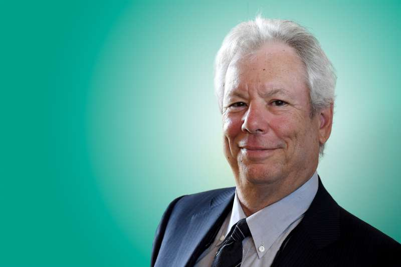In this June 22, 2014 file photo, US economist Richard Thaler poses for a photo during the award ceremony for the world economy prize in Kiel, Germany. The Nobel economics prize has been awarded to Thaler of the University of Chicago for his contributions to behavioral economics.