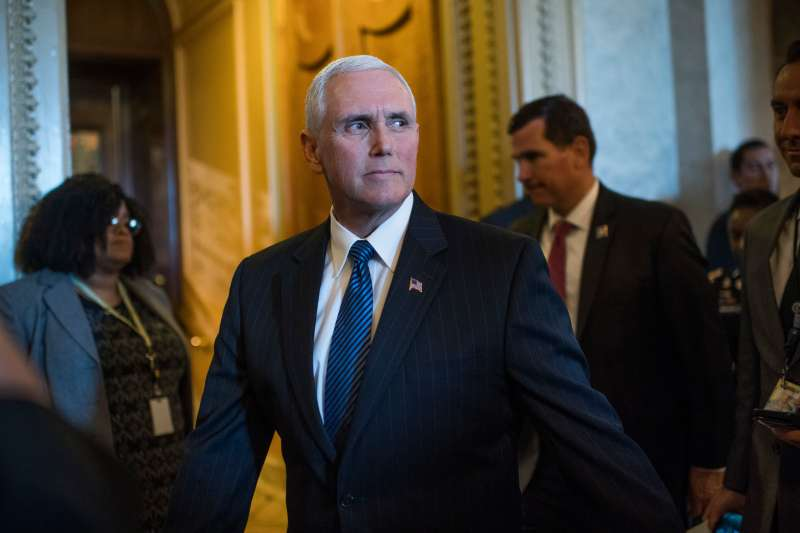 Vice President Mike Pence leaves the Senate chamber after a vote in the Capitol on May 10, 2017.