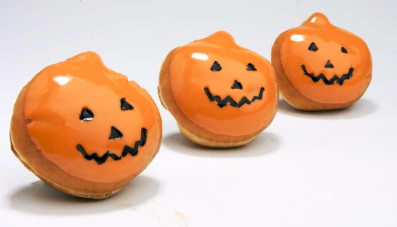 Krispy Kreme's signature doughnut gets a jack-o'-lantern shape and sweet orange frosting for Halloween