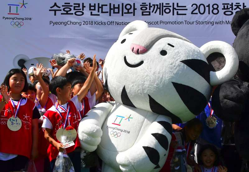 South Korean students react to one of the mascots for the 2018 Pyeongchang Winter Olympics, a white tiger named  Soohorang , during the mascots' first public staging event at Hoenggye elementary school in Pyeongchang, about 150 kms east of Seoul, on July 18, 2016.             The PyeongChang 2018 Organizing Committee announced a nationwide mascot promotion tour, plus a tour to the Rio Games for more active international promotion as well as a reach to major cities and festivals in South Korea. / AFP / JUNG YEON-JE        (Photo credit should read JUNG YEON-JE/AFP/Getty Images)