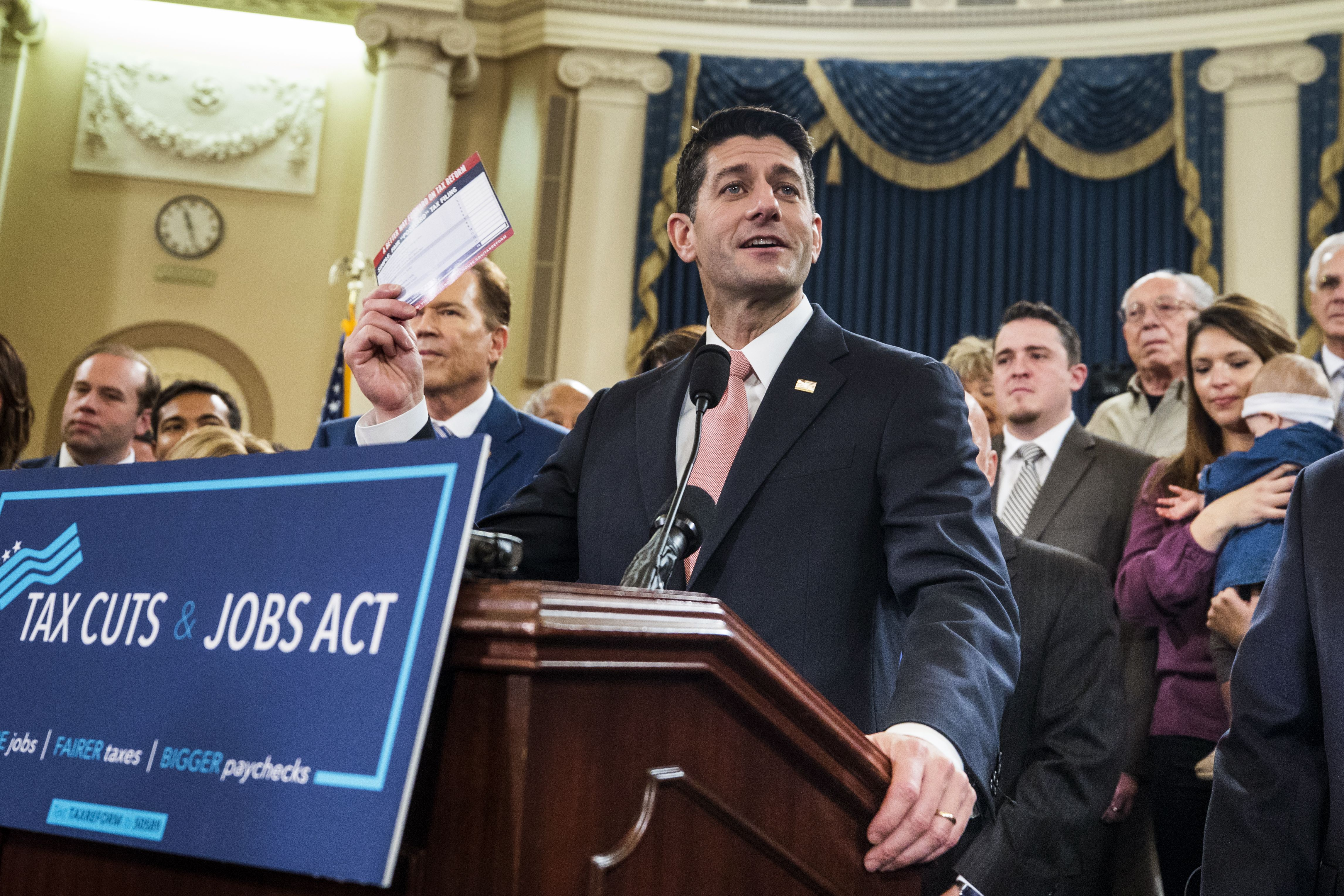 Republican Speaker of the House Paul Ryan (C), along with other House Republicans, speaks about the GOP tax overhaul in the Longworth House Office Building in Washington, DC, November 2, 2017. The plan seeks up to six trillion dollars in tax cuts over 10 years.