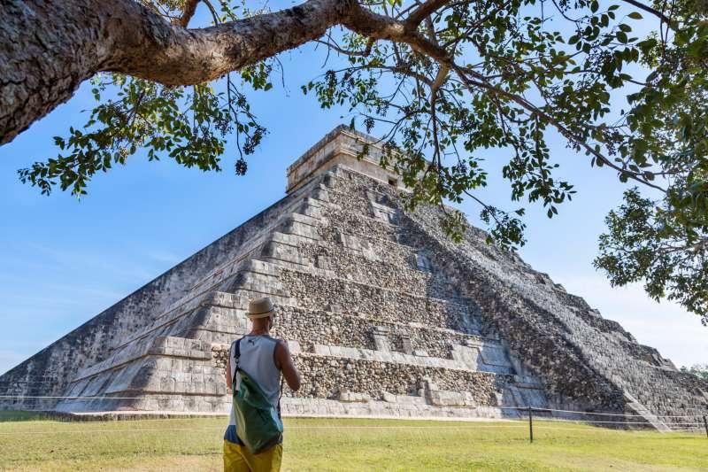 Tourist in front of El Castillo temple, Chichen Itza, Yucatan, Mexico