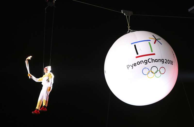 South Korean Ryu Seung-min, a member of the IOC Athletes Commission, carries the Olympic torch as he hangs from a wire during the Olympic Torch Relay in Incheon, South Korea, . The Olympic flame arrived in South Korea Wednesday where it will be passed throughout the country by thousands of torchbearers on a 100-day journey to the opening ceremony of the 2018 Winter Olympics in Pyeongchang             Pyeongchang Olympics Flame Arrival, Incheon, South Korea, November 1, 2017.