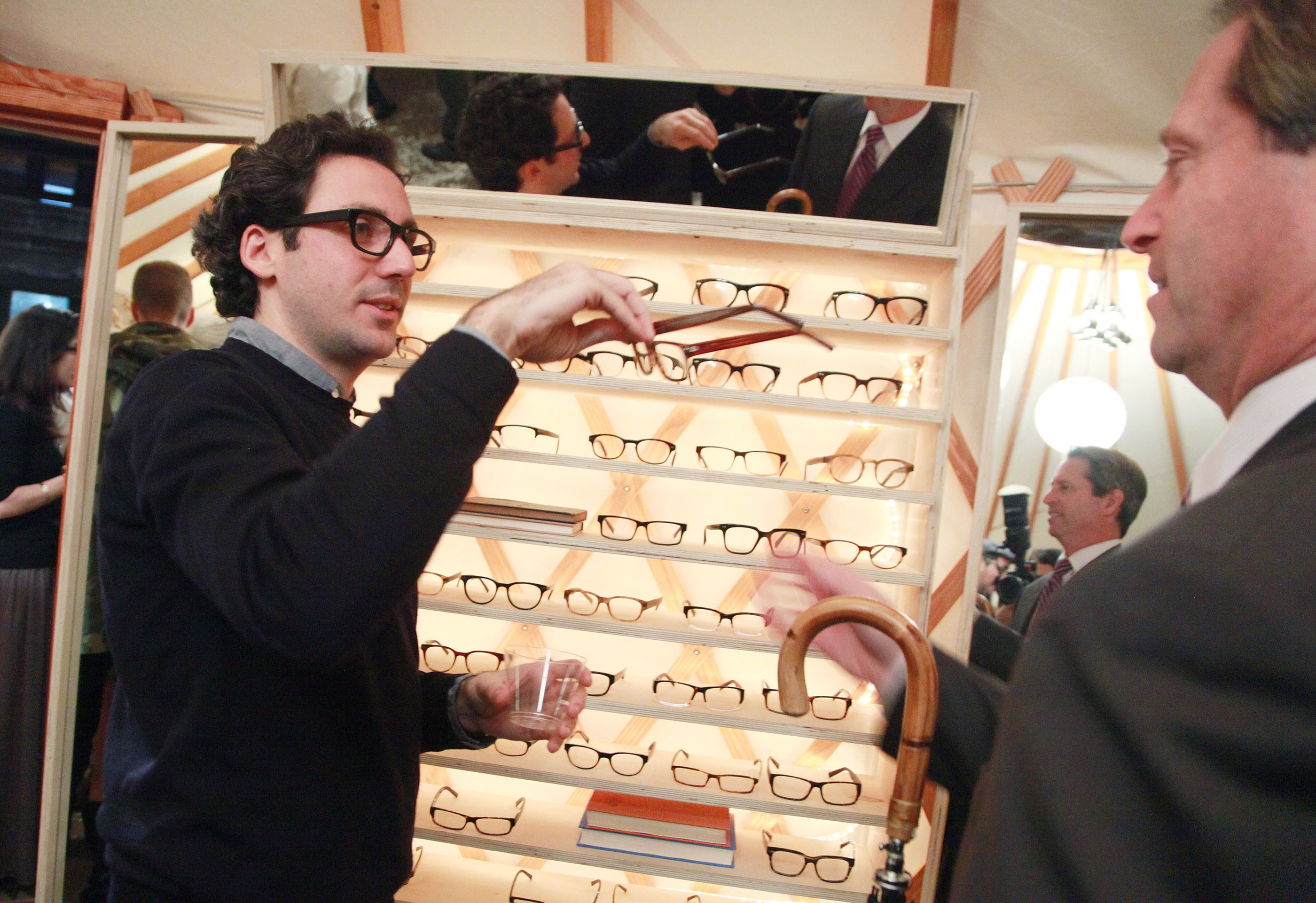 Neil Blumenthal shows Warby Parker optical frames at the Warby Parker's holiday spectacle bazaar - leftover launch on November 29, 2011 in New York City.