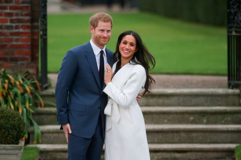 Britain's Prince Harry and his fiancée US actress Meghan Markle pose for a photograph