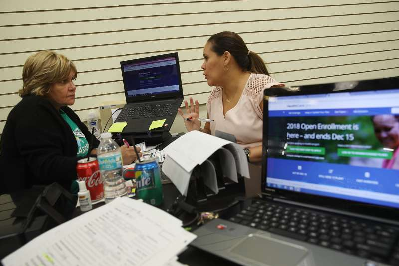Margarita Mills (L), an insurance agent from Sunshine Life and Health Advisors, speaks with Daniela Morales as she shops for insurance under the Affordable Care Act at a store setup in the Mall of Americas  on November 1, 2017 in Miami, Florida. The open enrollment period to sign up for a health plan under the Affordable Care Act started today and runs until Dec. 15.