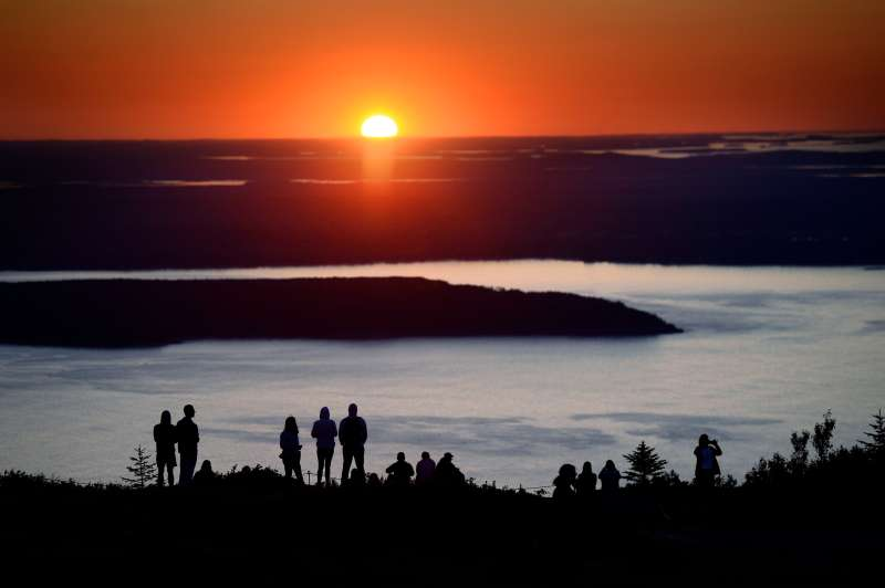 Hundreds of visitors flock to Cadillac Mountain in Acadia National Park to watch the sunrise Monday, July 31, 2017. At 1530 ft. Cadillac Mountain is the tallest mountain along the Eastern Coast of the United States. (Staff photo by Shawn Patrick Ouellette/Portland Press Herald via Getty Images)