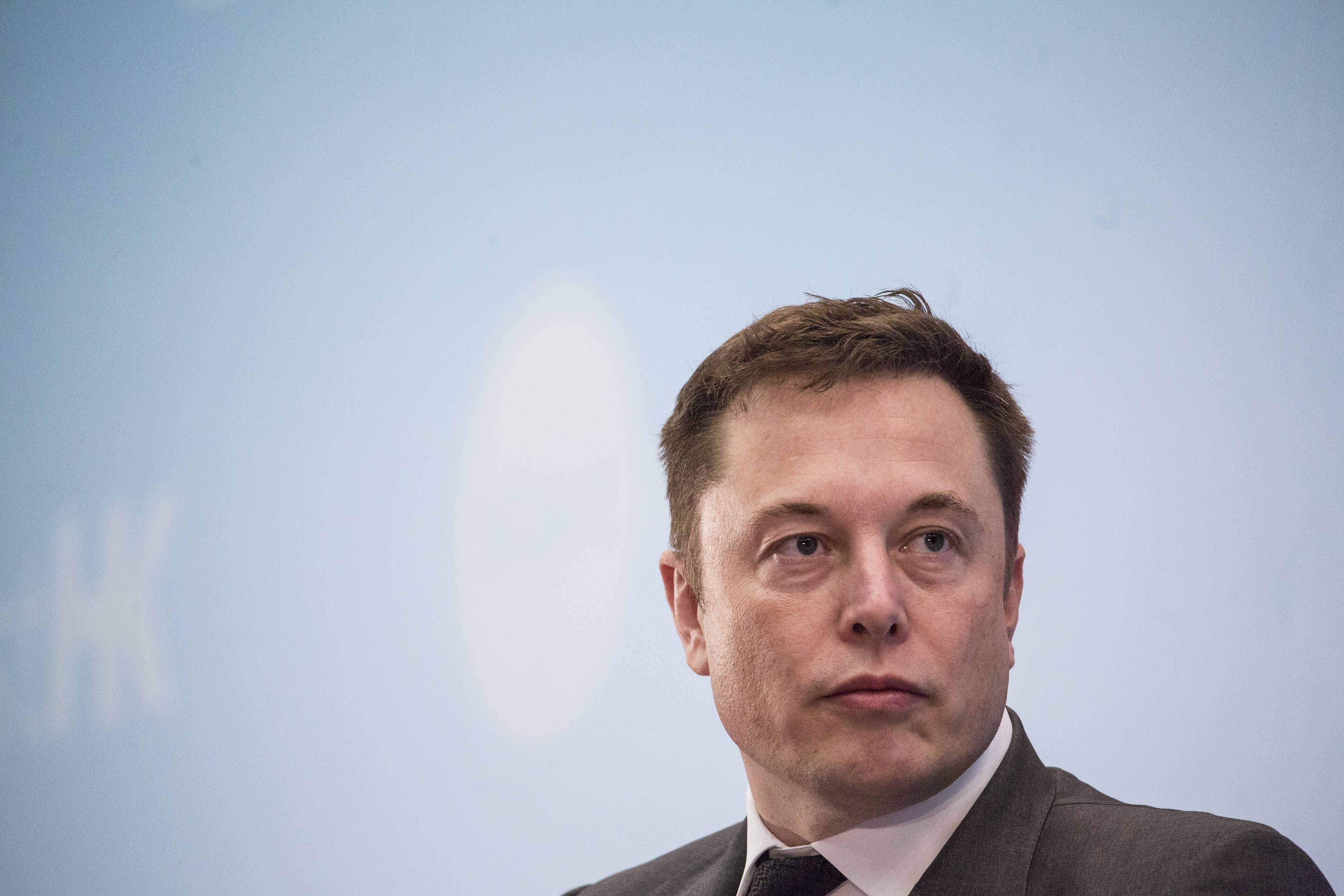 Billionaire Elon Musk, chief executive officer of Tesla Motors Inc., listens during the StartmeupHK Venture Forum in Hong Kong, China, on Tuesday, Jan. 26, 2016. Tesla is looking for a Chinese production partner but is  still trying to figure that out,  Musk said. Photographer: Justin Chin/Bloomberg via Getty Images