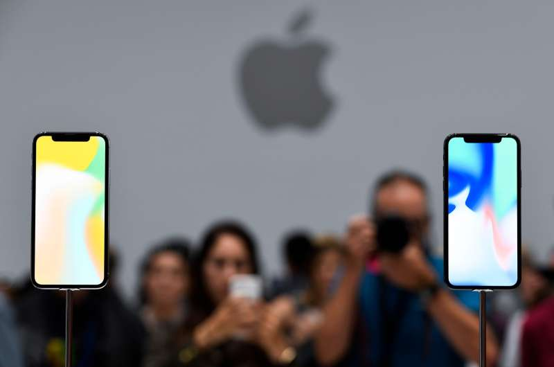 CUPERTINO, CA - SEPT. 12: Attendees take photos of iPhone X during the Apple launch event on Sept. 12, 2017.