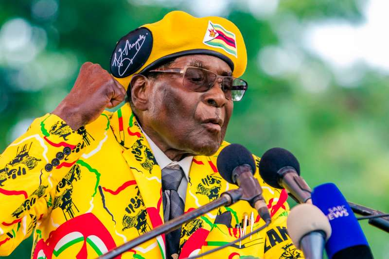 Zimbabwe's President Robert Mugabe addresses party members and supporters gathered at his party headquarters