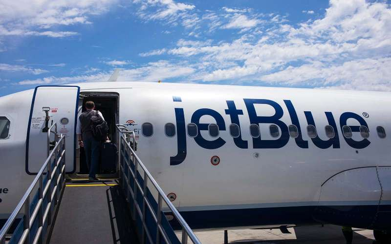 Passengers board a JetBlue Airways flight to New York May 24, 2017 in the Long Beach Airport in Long Beach, California.
