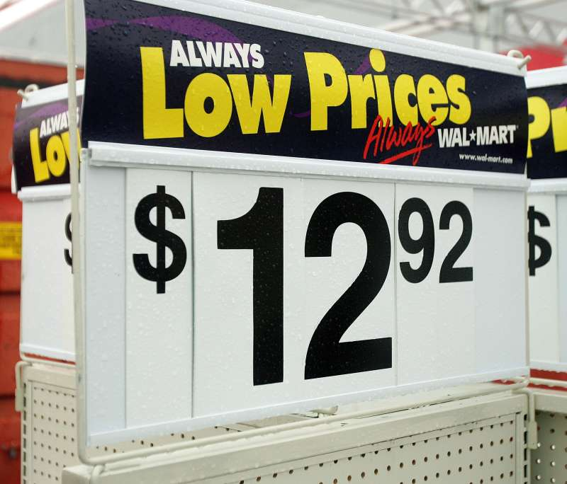 Wal-Mart  Always Low Prices  signage is seen in an outside back storage area of a Wal-Mart store in Illinois.