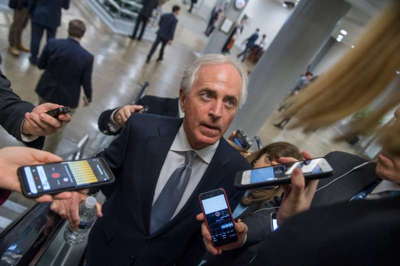Sen. Bob Corker, R-Tenn., talks with reporters in the basement of the Capitol before the Senate Policy luncheons on December 12, 2017.