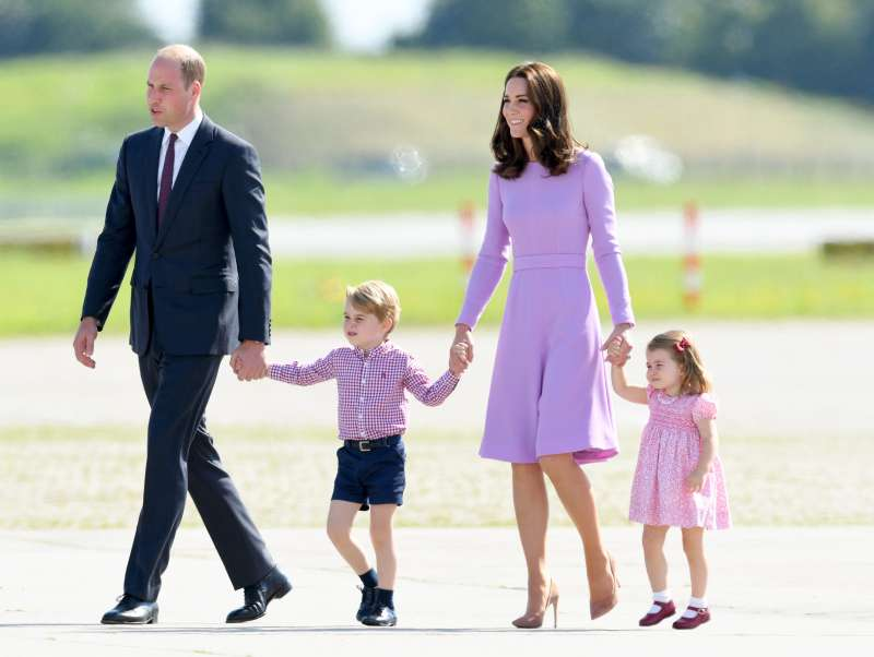 Prince William, Duke of Cambridge, Prince George, Princess Charlotte of Cambridge and Catherine, Duchess of Cambridge view helicopter models H145 and H135 before departing from Hamburg airport on the last day of their official visit to Poland and Germany on July 21, 2017 in Hamburg, Germany.
