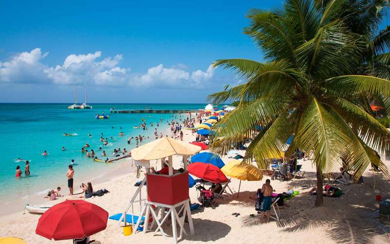 People relax and swim at Doctor's Cave beach, Montego Bay, St. James, Jamaica, Caribbean