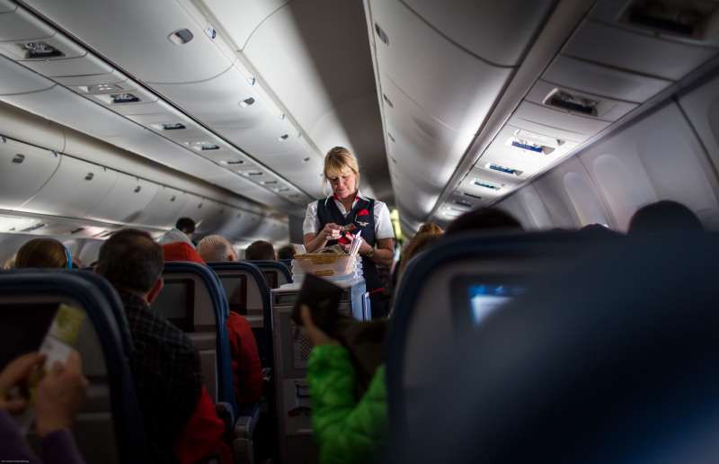 A Delta Airlines stewardess sells food on board a San Francisco, California bound plane.
