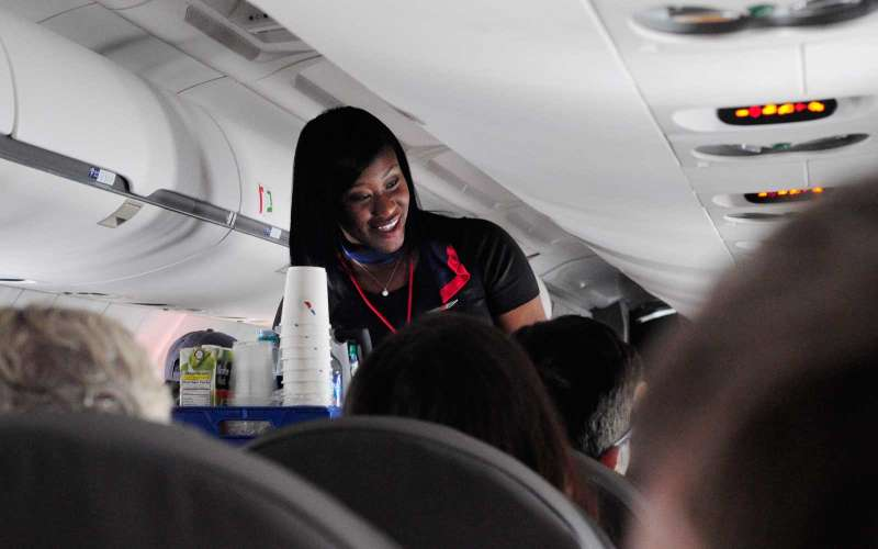 DALLAS, TX - OCTOBER 4, 2017:  An American Airlines flight attendant serves drinks to passengers after departing from Dallas/Fort Worth International Airport in Texas. (Photo by Robert Alexander/Getty Images)