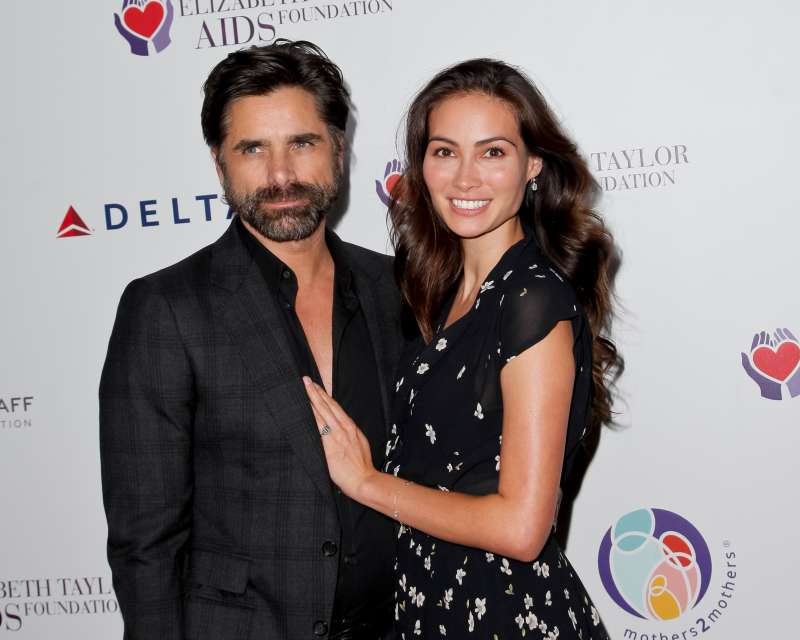 John Stamos and Caitlin McHugh attend a benefit dinner on Oct. 24, 2017 in Beverly Hills, California.