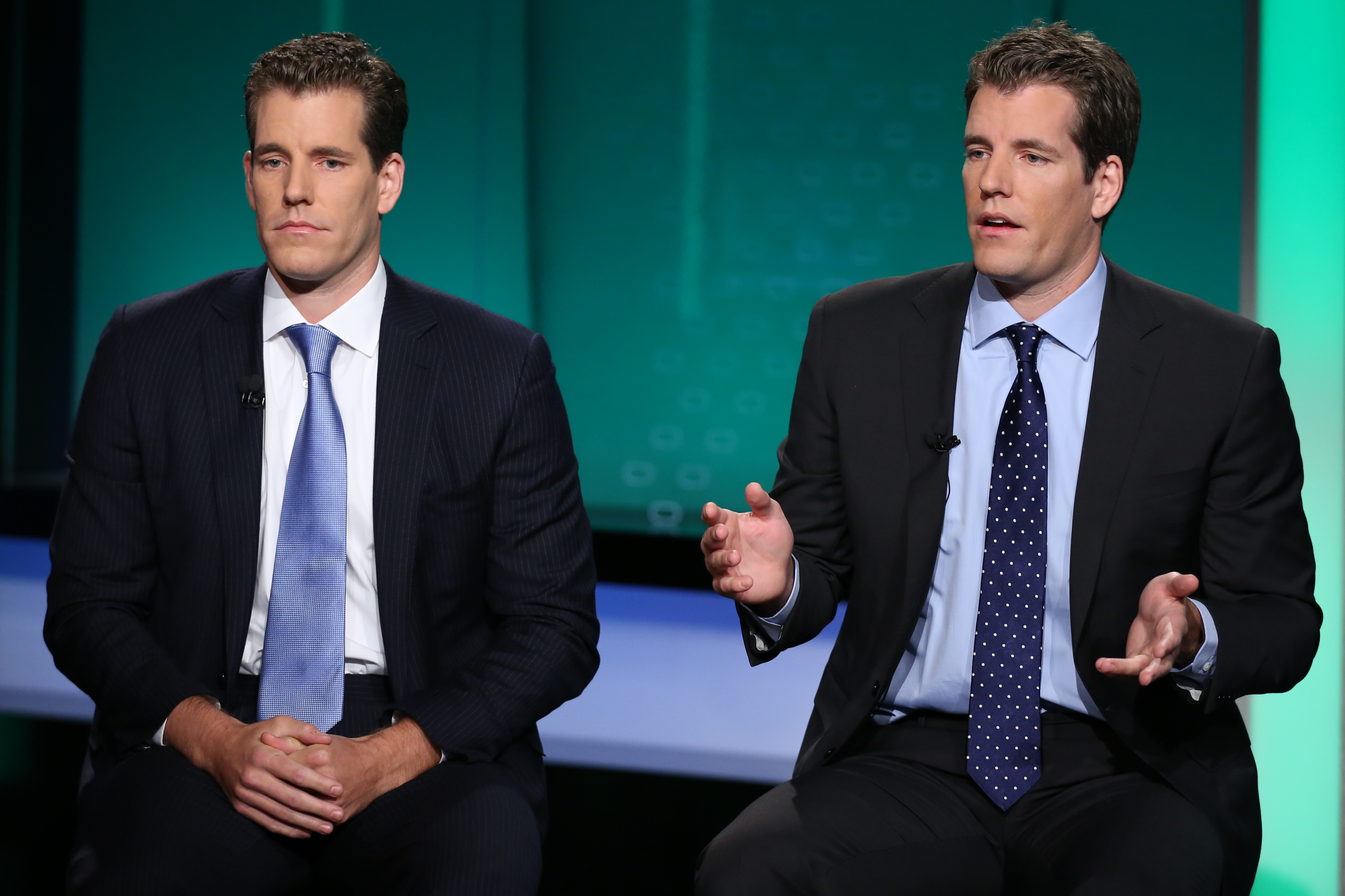 Cameron (L) and Tyler Winklevoss, discuss Gemini Trust Company, their new bitcoin exchange.
