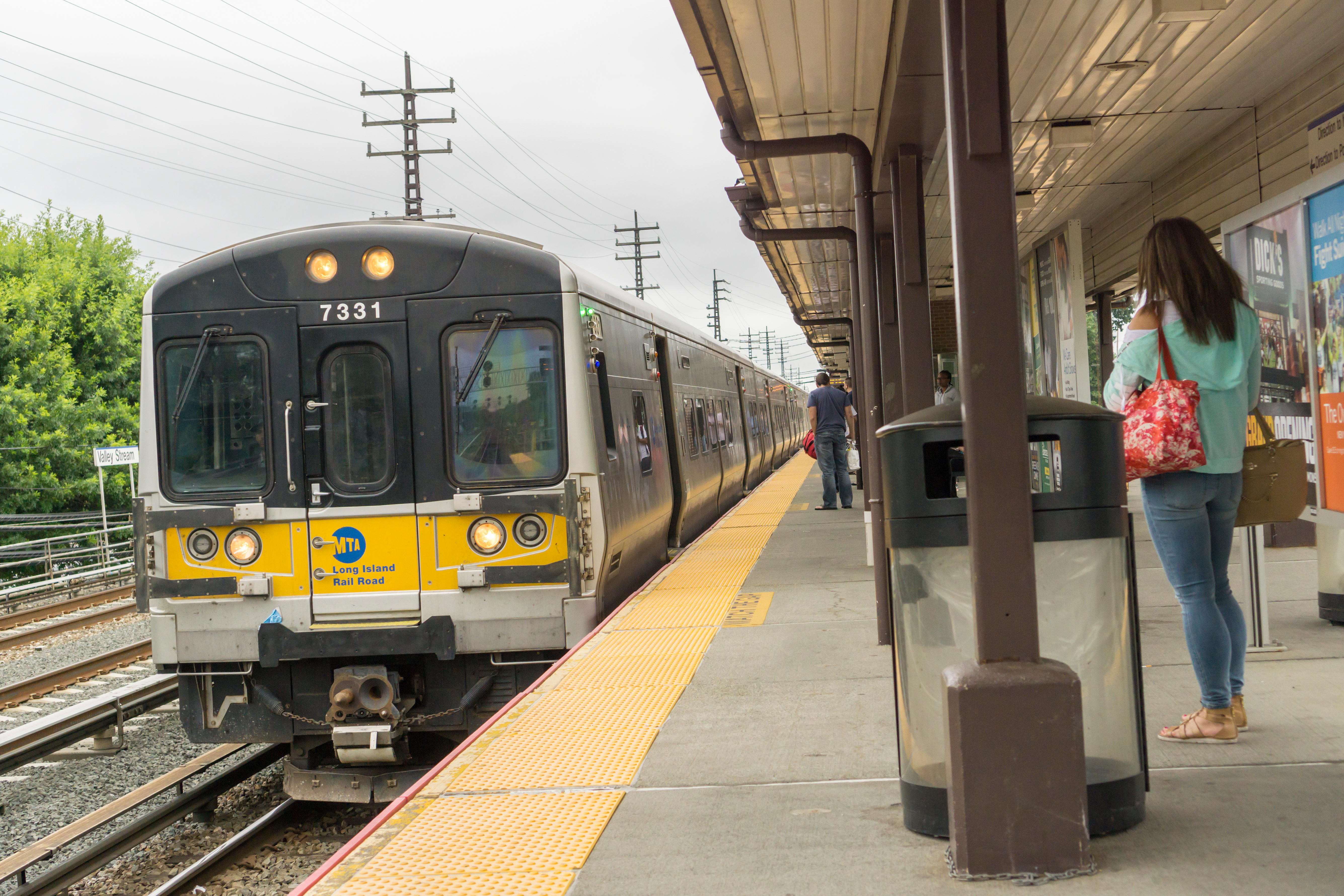 A Long Island Railroad (LIRR) commuter train arrives at the Valley Stream, Long Island station on Saturday, July 9, 2016. (© Richard B. Levine)