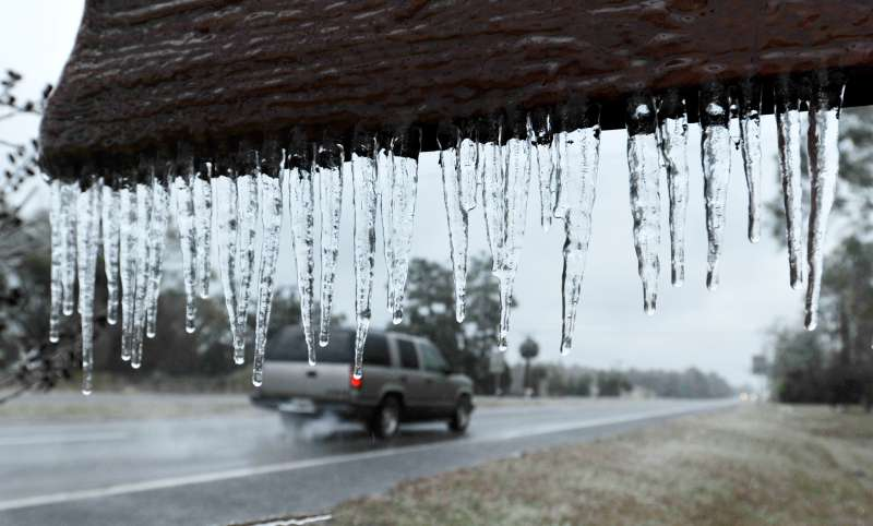 Icicles hang from the  Welcome to Hilliard sign  in Hilliard, Fla., Wednesday, Jan. 3, 2018. A brutal winter storm scattered a wintry mix of snow, sleet and freezing rain from normally balmy Florida up the Southeast seaboard Wednesday. (Bob Self/The Florida Times-Union via AP)