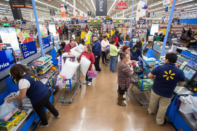 Walmart customers checkout at the retailer's Black Friday event with big savings on hundreds of top items on Thursday, Nov. 26, 2015 in Rogers, Ark.