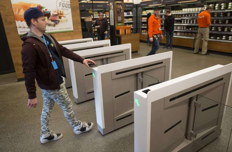 An Amazon.com Inc. employee scans in to shop at the Amazon Go store in Seattle, Washington, on January 17, 2018.