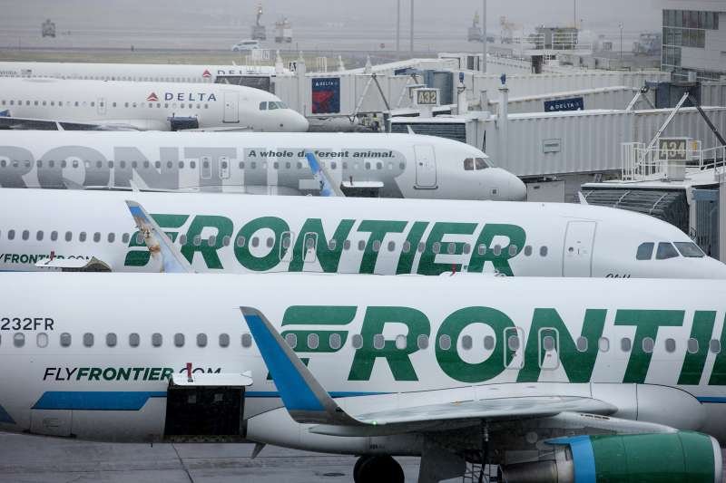 Frontier Airlines Inc. planes sit on the tarmac at Denver International Airport.