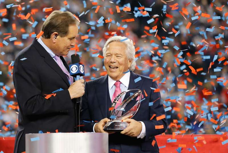 FOXBOROUGH, MA - JANUARY 21:  Owner Robert Kraft of the New England Patriots holds the Lamar Hunt trophy as he is interviewed by Jim Nantz after the AFC Championship Game against the Jacksonville Jaguars  at Gillette Stadium on January 21, 2018 in Foxborough, Massachusetts.  (Photo by Jim Rogash/Getty Images)