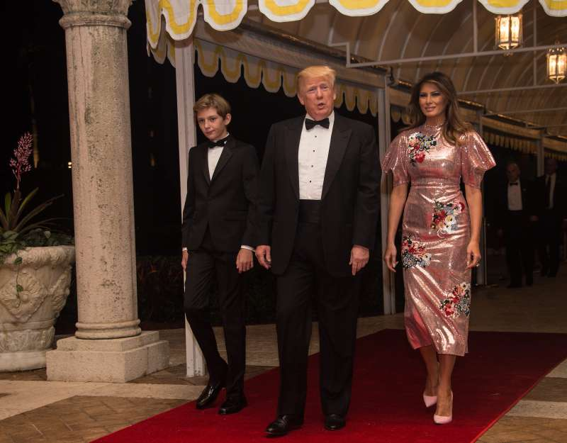 U.S. President Donald Trump, First Lady Melania Trump and their son Barron arrive for a new year's party at Trump's Mar-a-Lago resort in Palm Beach, Florida, on December 31, 2017.