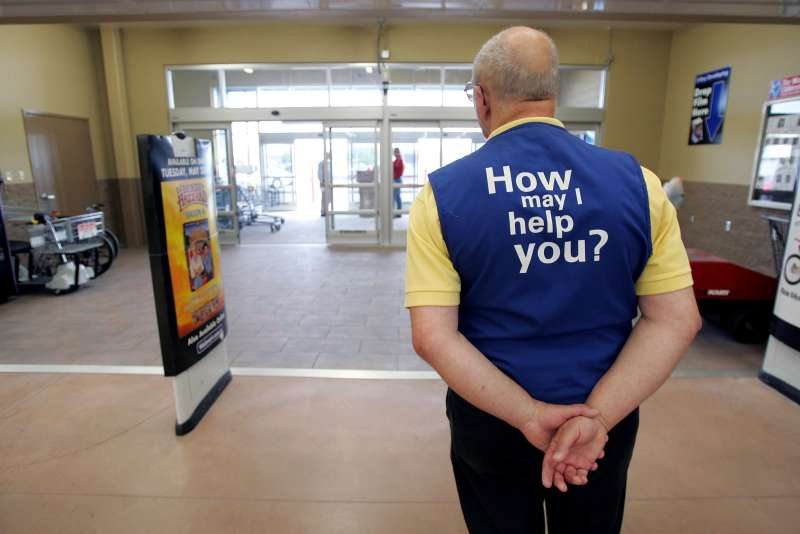 A Wal-Mart greeter waits to welcome new customers to the new 2,000 square foot Wal-Mart Supercenter store May 17, 2006 in Bowling Green, Ohio.