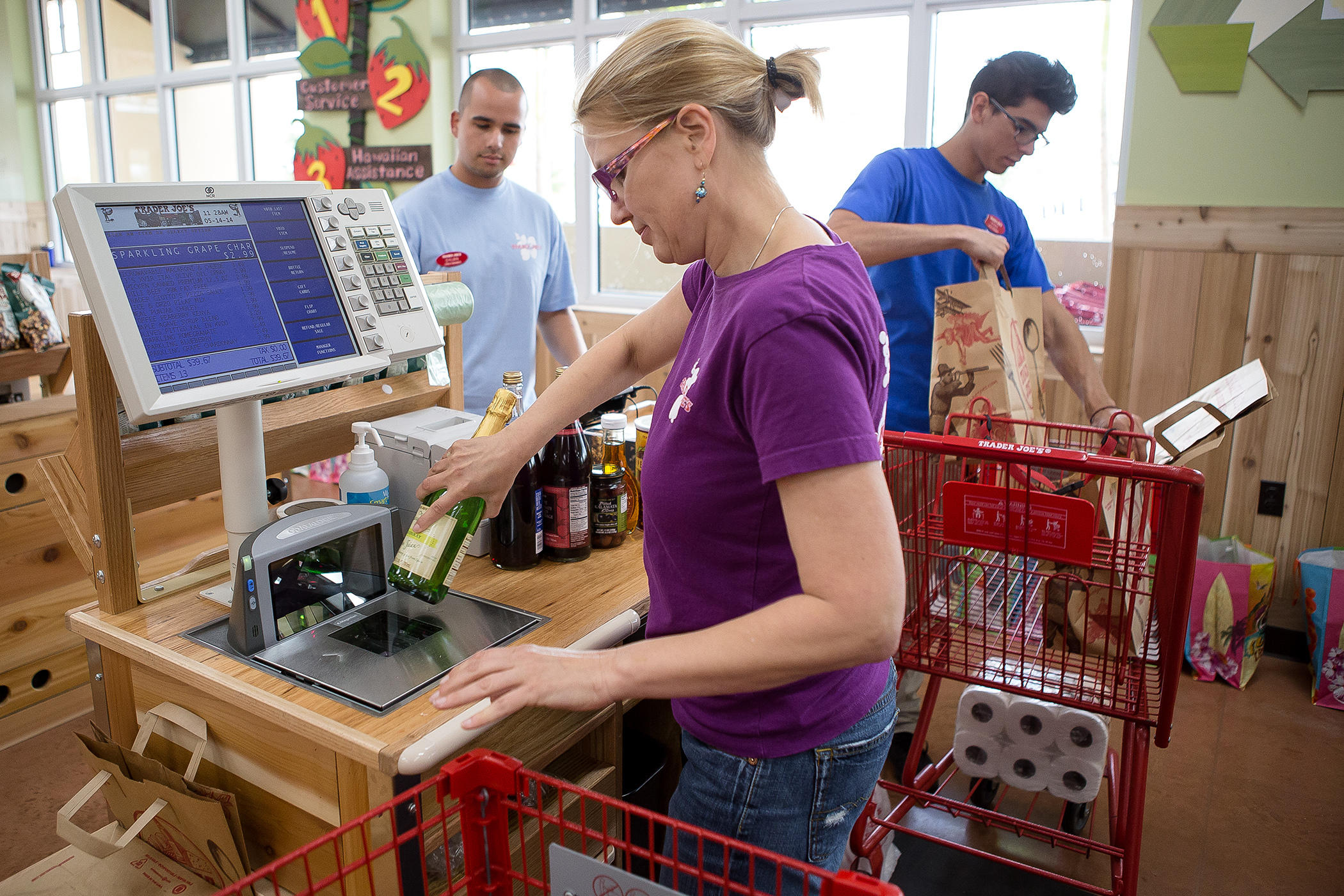 Wellington, Florida, USA. 14th May, 2014. NOTE: THESE PHOTOS MAY NOT APPEAR ANYWHERE (ONLINE OR IN PRINT) UNTIL 12:01 AM ON MAY 15. Lorraine Blake, center, of Wellington, practices working the cash register while Dylan Smith, left, of Wellington, and Ryan