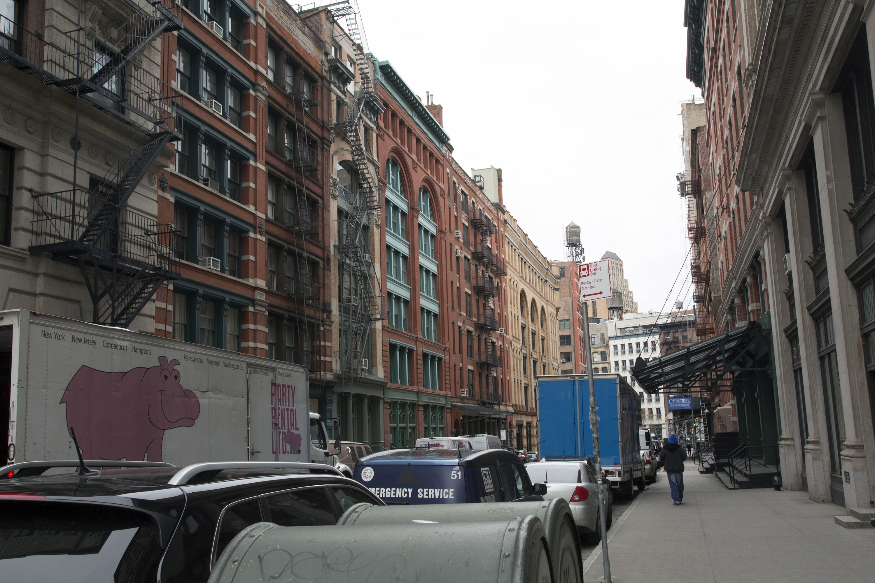 Swift's one-way cobblestone street in Tribeca is dotted with a mix of expensive housing, boutique shops, loading zones and empty storefronts.