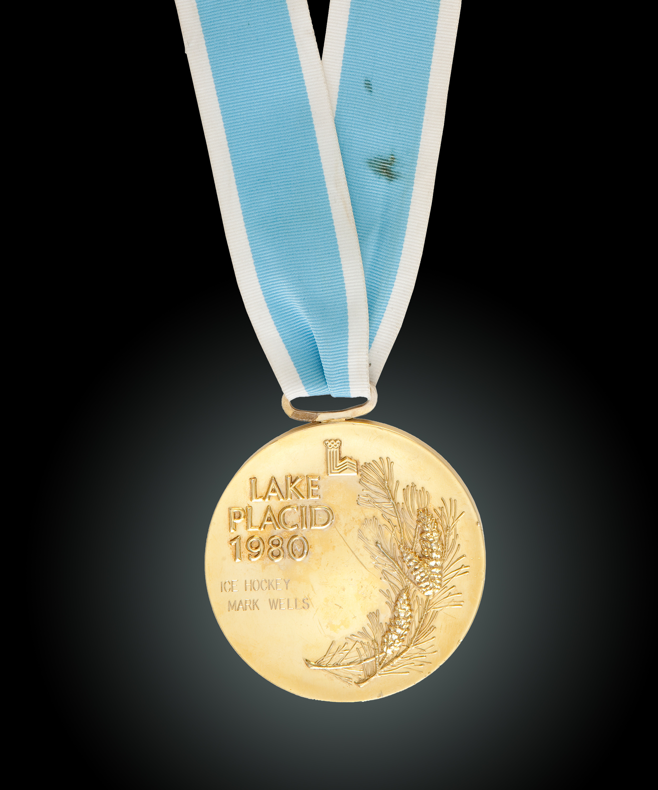 180209-olympic-medal-auction-mark-wells