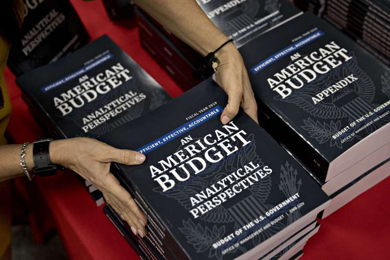 Copies of U.S. President Donald Trump's fiscal year 2019 budget request, An American Budget, are placed on display at the U.S. Government Publishing Office (GPO) library in Washington, D.C., on Feb. 12, 2018. Trump will propose cutting entitlement programs by $1.7 trillion, including Medicare, in a fiscal 2019 budget that seeks billions of dollars to build a border wall, improve veterans health care and combat opioid abuse and that is likely to be all but ignored by Congress.