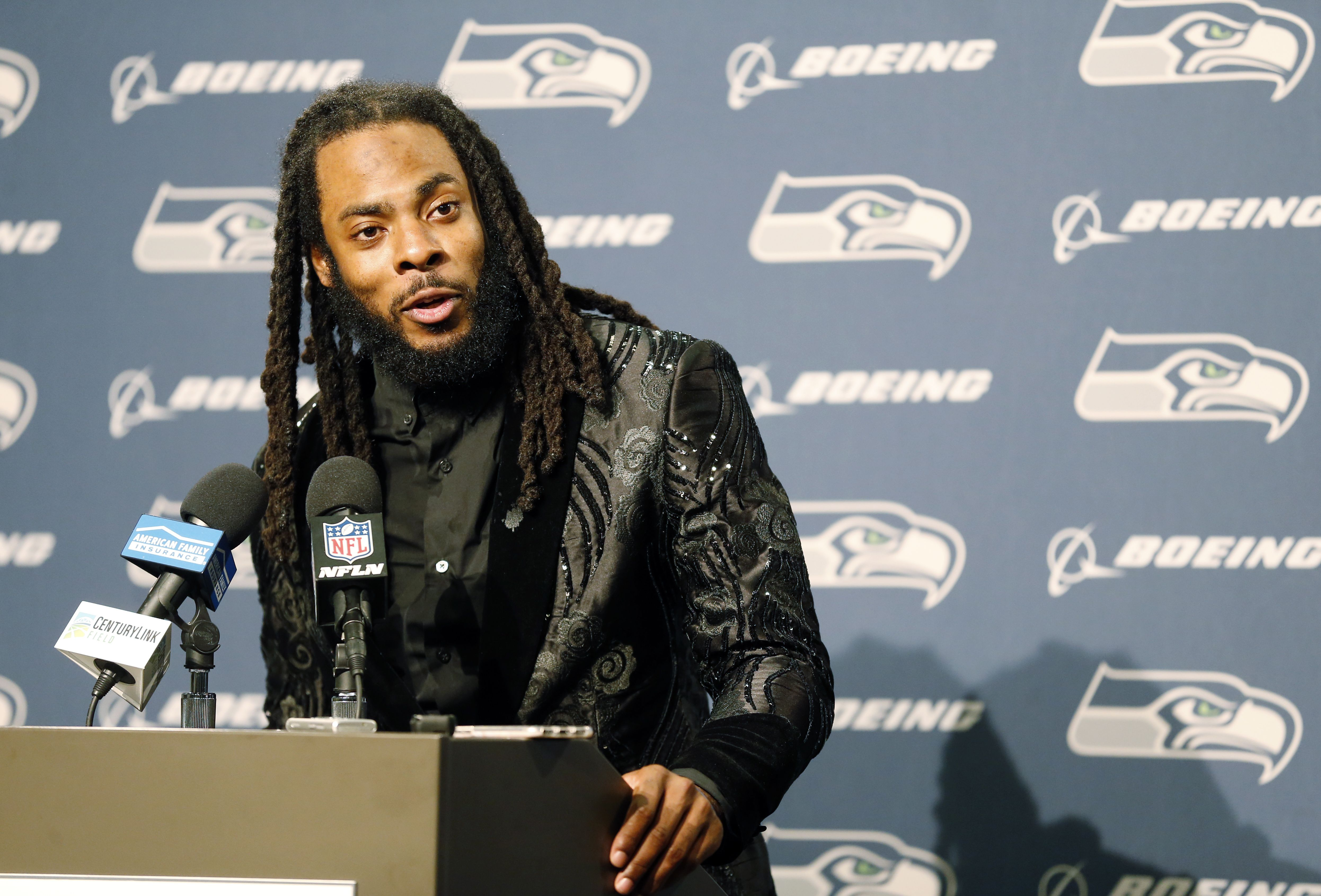 Seattle Seahawks cornerback Richard Sherman talks to reporters during a post-game press conference following an NFL football game against the Houston Texans, in Seattle, October 29, 2017.