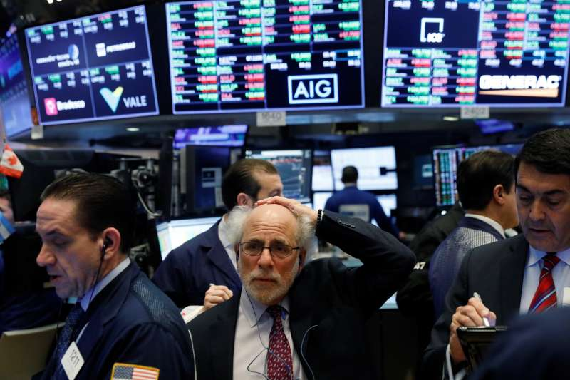 Traders work on the floor of the New York Stock Exchange shortly after the opening bell in New York, February 15, 2018.