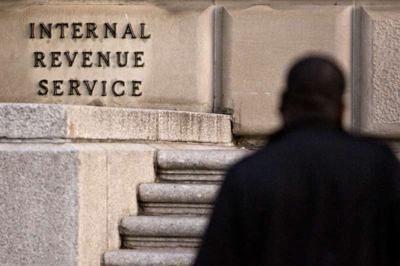 A man walks past the Internal Revenue Service (IRS) headquarters in Washington, D.C., on Oct. 20, 2017.