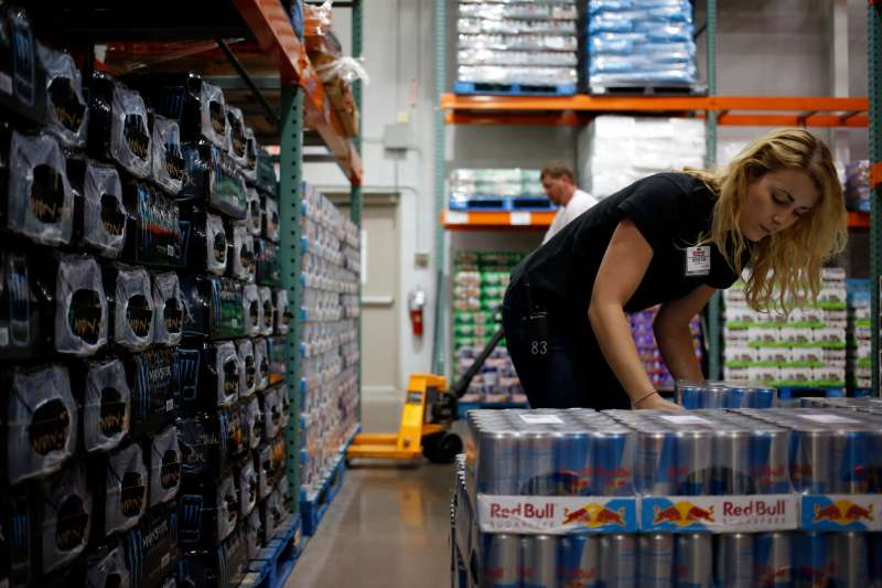 Employees stock shelves at a Costco Wholesale Corp. store in the morning before it opens in Louisville, Kentucky, U.S., on Thursday, May 29, 2014.