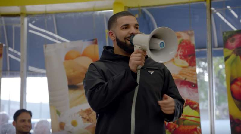Drake gives away a million dollars in his new video God's Plan.