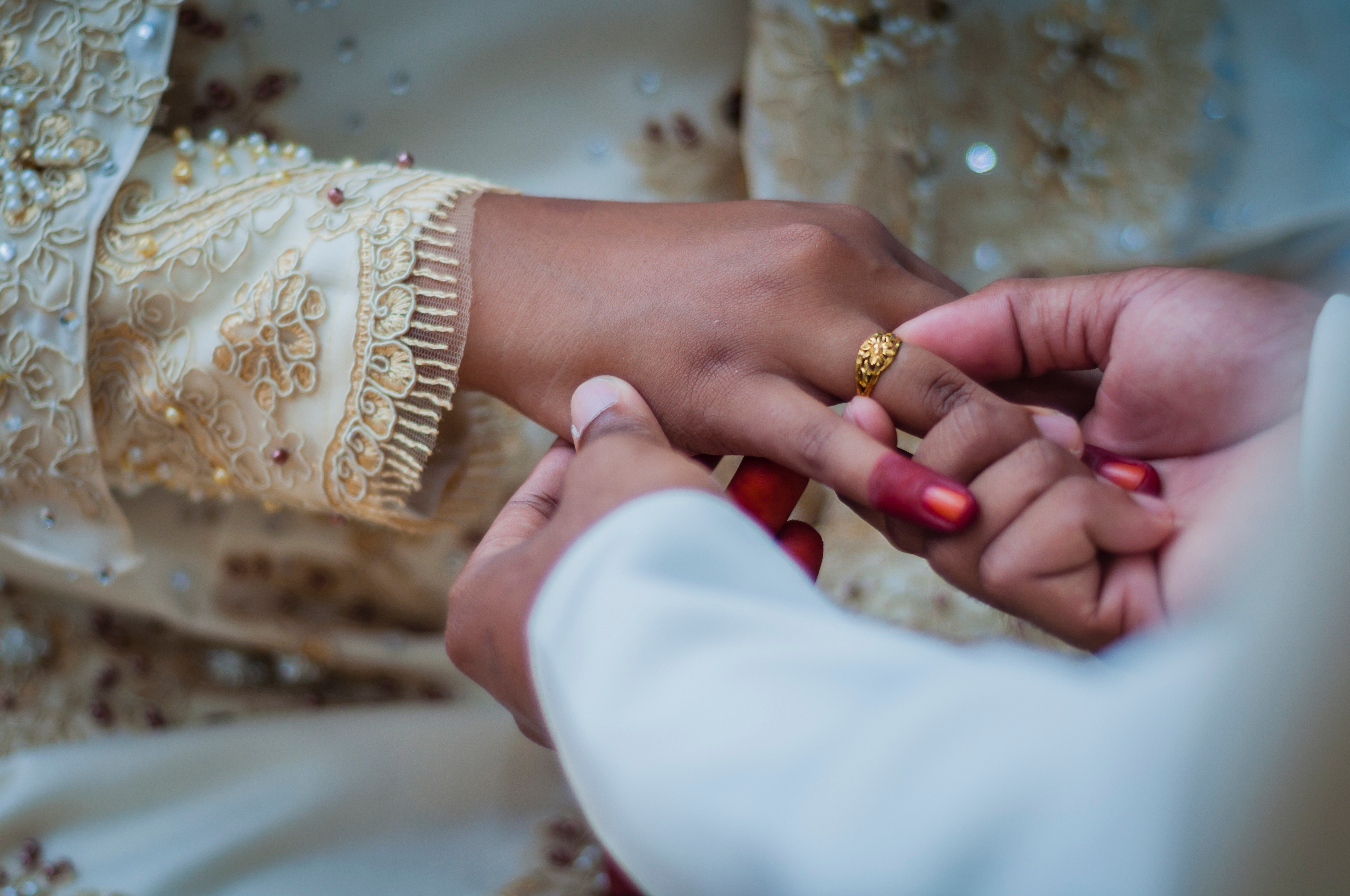Man Putting Engagement Ring To Woman During Ceremony
