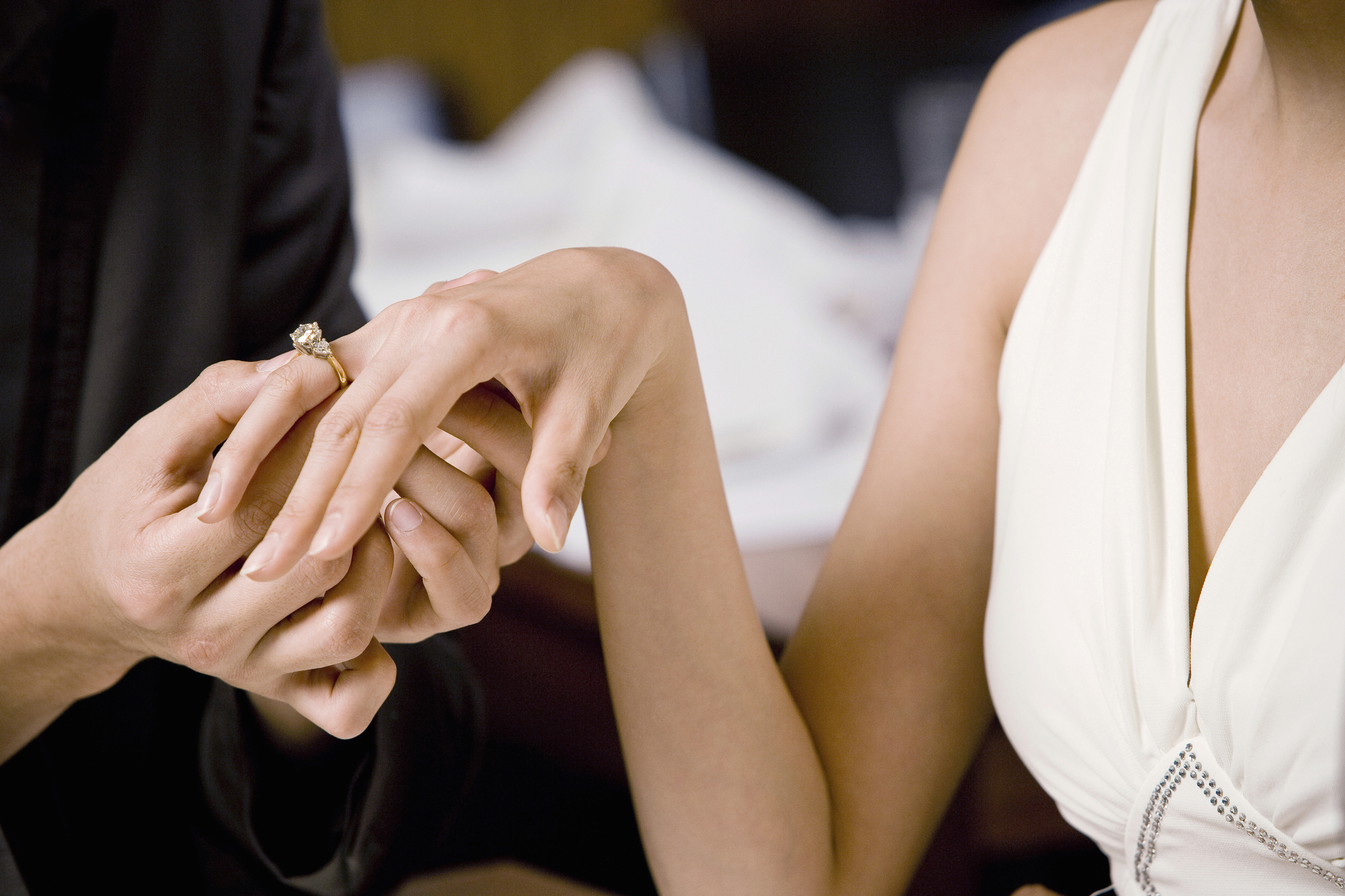 Young man proposing to young woman