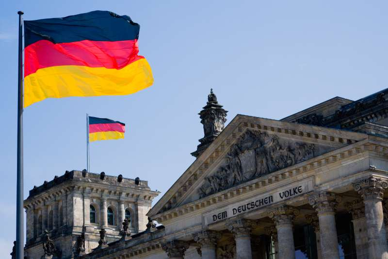German flags fly at the Reichstag building in Berlin