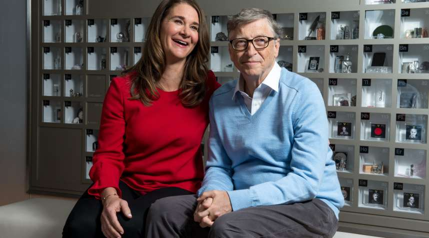Bill Gates and Melinda Gates pose for a portrait in their personal office