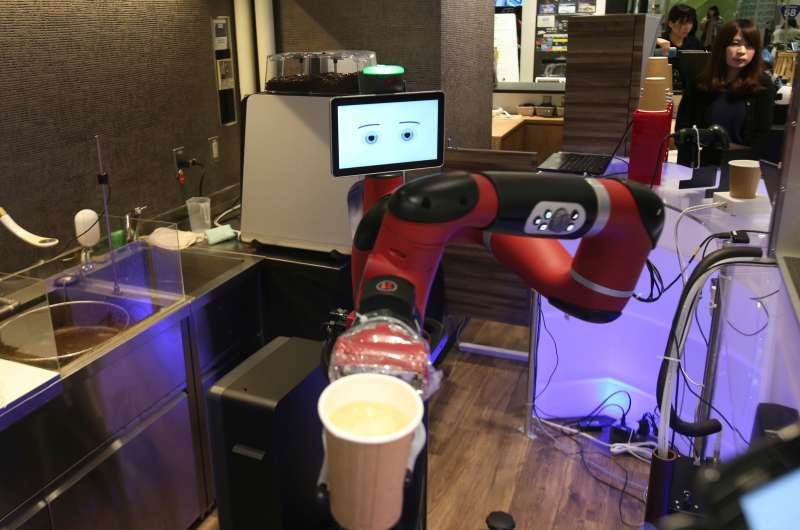 Robot barista named  Sawyer  makes a coffee at Henn-na Cafe in Tokyo, on Feb. 2, 2018