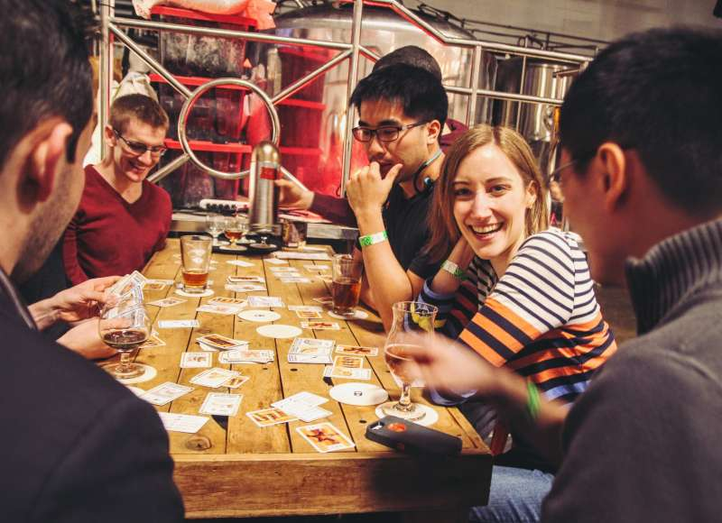Beer drinkers play cards at Aeronaut Brewing.